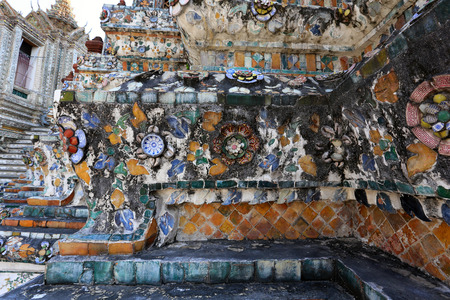 close-up fragment of mosaic plaster walls of a Buddhist temple photo