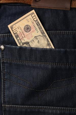 denim trousers: close-up of dollar bills pocket denim trousers, studio