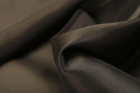 black satin: macro texture of soft bends of black satin studio Stock Photo