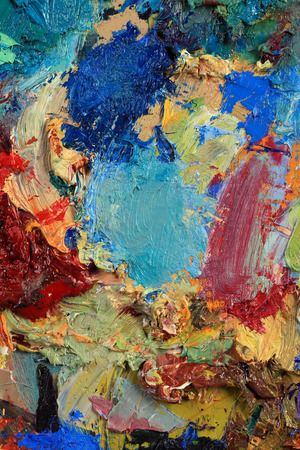 saturation: macro artists palette, texture mixed oil paints in different colors and saturation studio