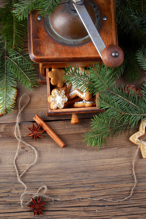 close-up of beautiful festive Christmas still life of the branches of spruce, cookies and spice on wood with cracks studio photo