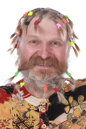 close-up portrait of a man with braids, mustache and beard in colored shirt on a white background studio