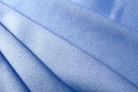 folds: macro texture of blue fabric folds studio Stock Photo