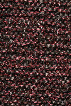 macro texture of burgundy knitted fabric studio photo