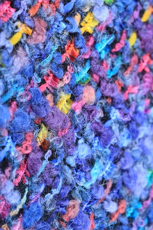art materials: macro texture wool black fabric with colored speckles studio