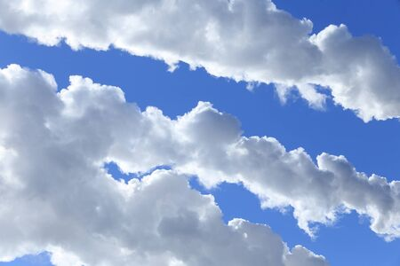 forecast: close-up of white smoke against a blue sky on a sunny day Stock Photo