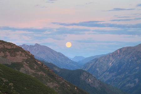picturesque landscape moonrise in the Baikal Mountains during the night summer night photo