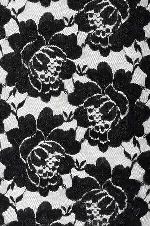 macro lace with black flowers on white background studio photo