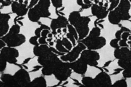 underclothing: macro lace with black flowers on white background studio