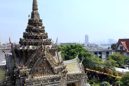derives: BANGKOK, THAILAND - December 15, 2014: Wat Arun (Temple of Dawn) Temple derives name from the Hindu god Aruna, personified as the radiations of the rising sun. Stock Photo