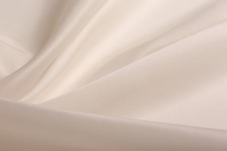 Macro textuur van de satijnstof-champagne gekleurde studio Stockfoto - 38242803