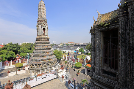 radiations: BANGKOK, THAILAND - December 15, 2014: Wat Arun (Temple of Dawn) Temple derives name from the Hindu god Aruna, personified as the radiations of the rising sun. Editorial