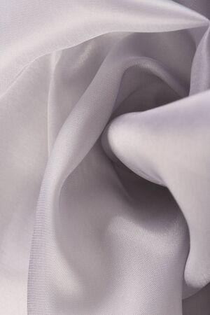 folds: macro texture folds white-gray satin studio Stock Photo