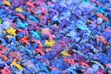 speckles: macro texture wool black fabric with colored speckles studio
