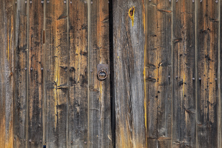 balk: macro texture wall fragment of the old wooden house in the sunlight