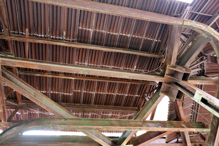 close-up of old rusty metalwork, leaky roof and the rack from the bottom up view photo