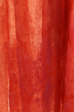 translucent red: macro translucent red fabric with an openwork pattern