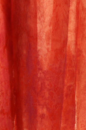 macro translucent red fabric with an openwork pattern