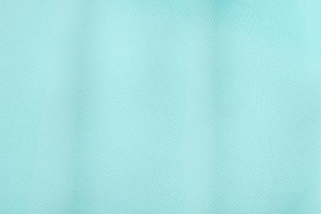 celadon blue: macro texture fragment of tissue aqua, studio Stock Photo