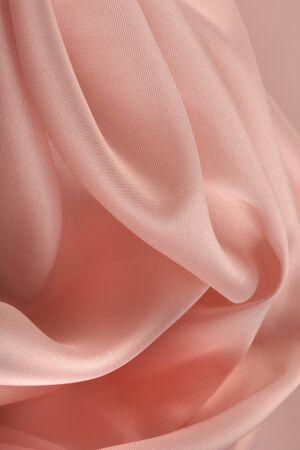 folds: macro texture of pink chiffon folds studio Stock Photo