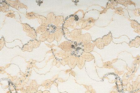 underclothing: macro beige lace with flowers on white background studio Stock Photo