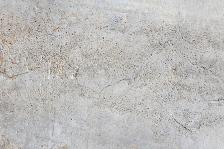 macro texture fragment of the concrete slab with cracks in the sunlight in the winter Stock Photo