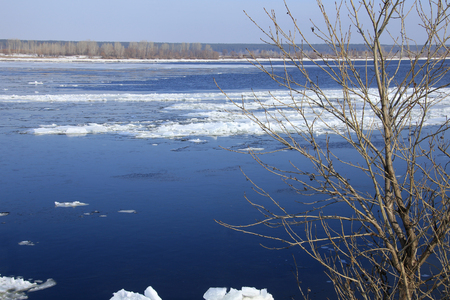 landscape ice drift on the river in the spring on a sunny day photo