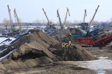sand quarry: industrial landscape extraction of sand in the river port in the early spring Stock Photo