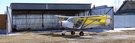 hangar: close-up of a small plane near hangar early spring