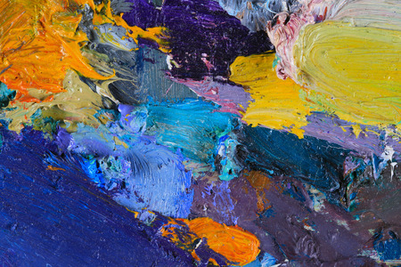 abstract painting: macro artists palette, texture mixed oil paints in different colors and saturation studio