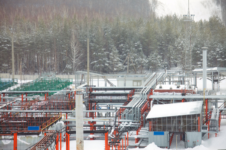 paesaggio industriale: Winter industrial landscape oil refinery in the forest
