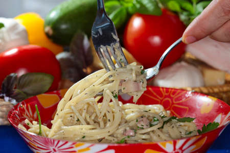 provision: macro appetizing Spaghetti with vegetables and cheese in red plate, studio