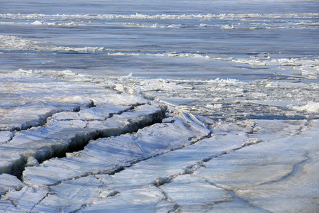 warming: landscape ice drift on the river in the spring on a sunny day Stock Photo