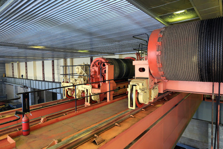 hydroelectric: Industrial interior hydroelectric turbine hall, turbines, equipment, cranes Editorial