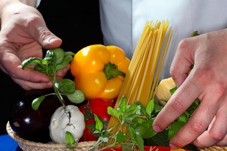 appetizing: macro appetizing set of products and spaghetti on dark background studio