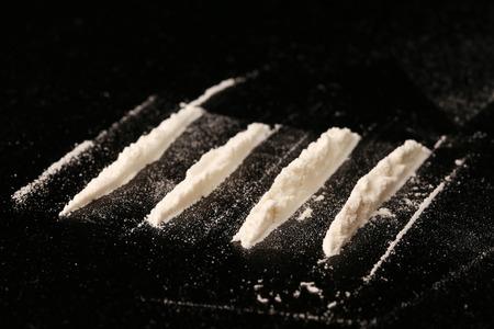 drug addict: close-up drugs on black background studio