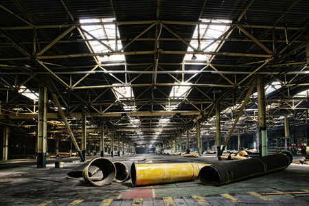 abandoned car: industrial interior of an abandoned building and repair work on the initial stage