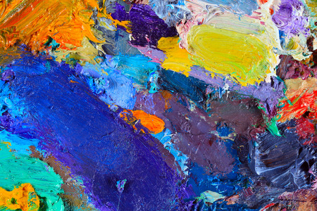 art abstract: macro artists palette, texture mixed oil paints in different colors and saturation studio