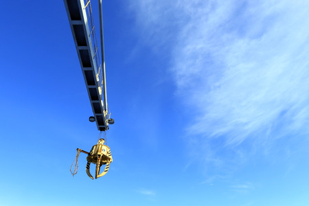 auto hoist: industrial landscape close-up gantry crane isolated on a blue sky background