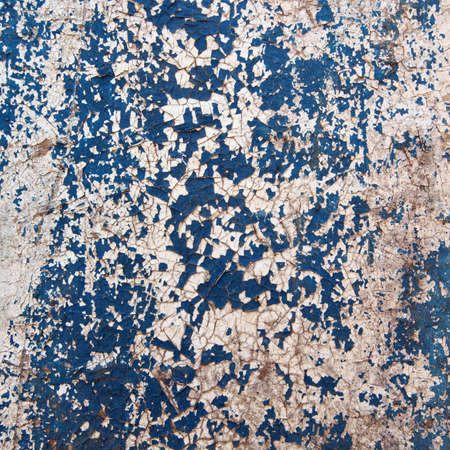dilapidated wall: macro isolated fragment of the old dilapidated wall painted white and blue Stock Photo