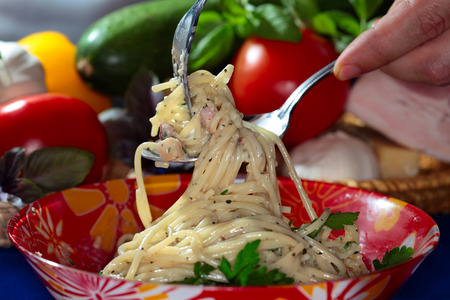 appetizing: macro appetizing Spaghetti with vegetables and cheese in red plate, studio