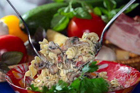 appetizing: macro appetizing set of products and pasta on dark background studio