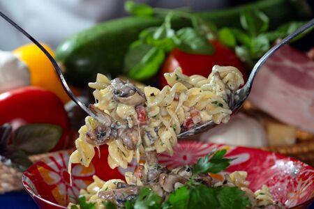 appetizing: macro appetizing Fusilli pasta with cheese on dark background studio Stockfoto