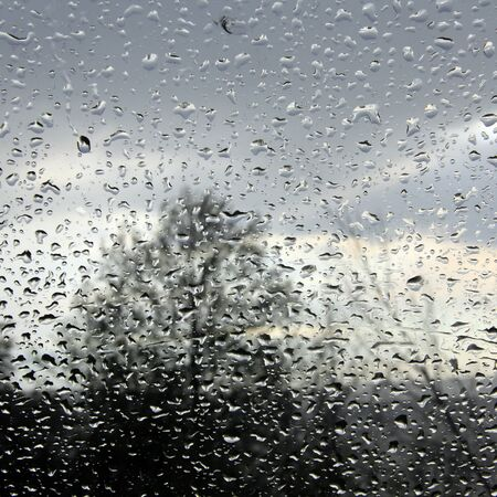 macro texture of raindrops on glass of the car spring
