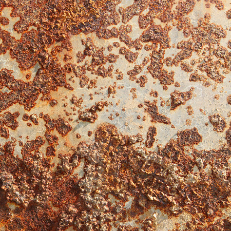 metal sheet: macro isolated texture of rusty sheet metal in the sunlight Stock Photo