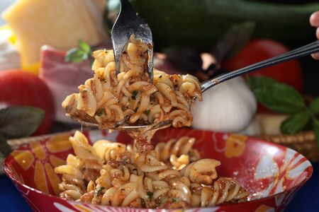 appetizing: macro appetizing Fusilli pasta with cheese and sauce on dark background studio Stockfoto