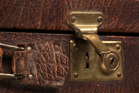 portmanteau: close-up fragment of locks and fasteners on the vintage leather suitcase brown Stock Photo