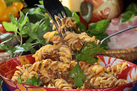 appetizing: macro appetizing Fusilli pasta with vegetables and cheese on dark background studio Stock Photo