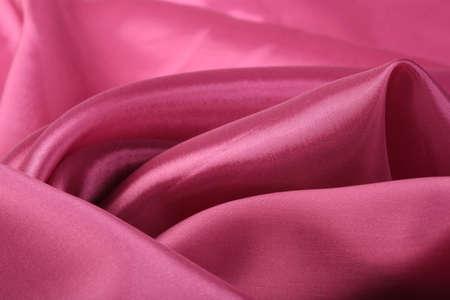 fuchsia color: macro texture of satin fabric fuchsia color studio Stock Photo