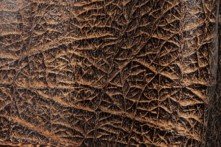 worn: macro texture fragment of the old worn brown leather Stock Photo